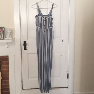 Blue and white striped jump suit.